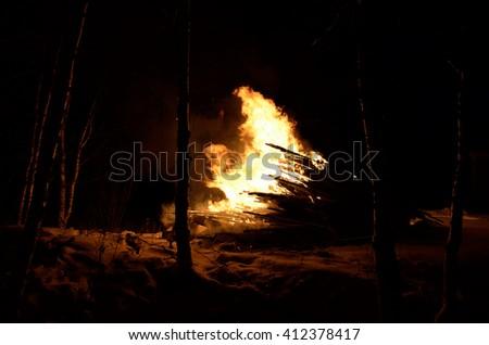 massive bonfire in winter night birch tree forest - stock photo
