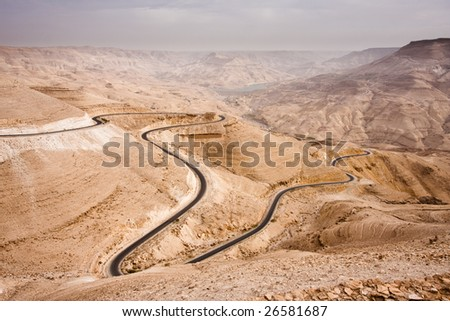 Massive canyon in the Jordan desert with the King's Highway - stock photo