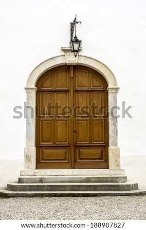 Massive entrance, wooden door of the castle. - stock photo