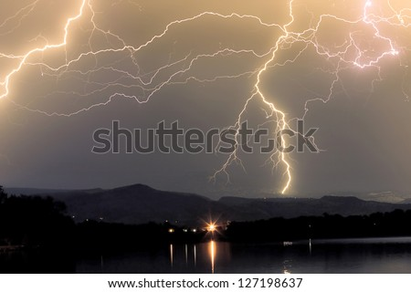 Massive Rocky Mountain Thunderstorm in the Boulder County font range Colorado Foothills. Cloud to Cloud and cloud to ground. - stock photo