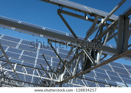 Massive solar power array above a parking garage generates a lot of energy, alleviating the need to pull power from the grid. - stock photo