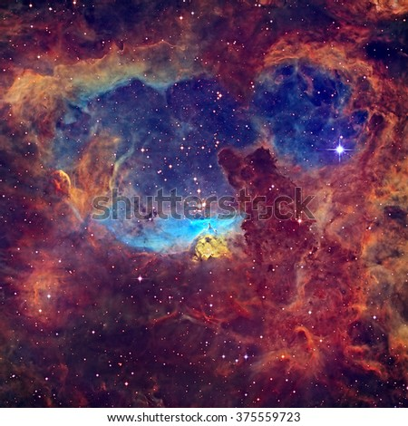 Massive stars lie within NGC 6357 (Lobster Nebula), an expansive emission nebula complex in the constellation Scorpius. Retouched colored image. Elements of this image furnished by NASA. - stock photo
