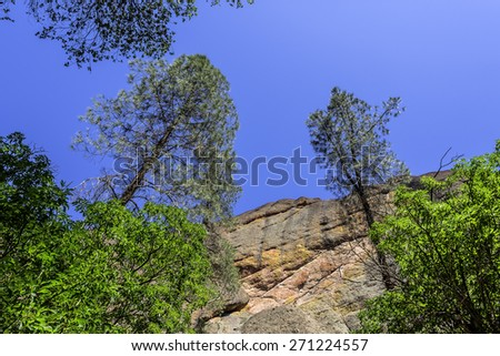 Massive vertical shear cliffs at Pinnacles National Park in Monterey County, California, near the Salinas Valley, on the California Central Coast. - stock photo