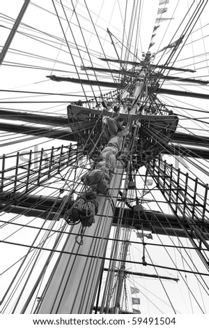 Mast and ropes of a classic sailboat, impression in black and white - stock photo