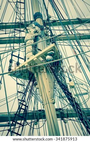 Mast and sailboat rigging, toning - stock photo
