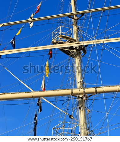 Mast of sailing ship against a blue sky. Image assembled from few frames  - stock photo