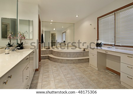 Master bath in home with step up tub - stock photo