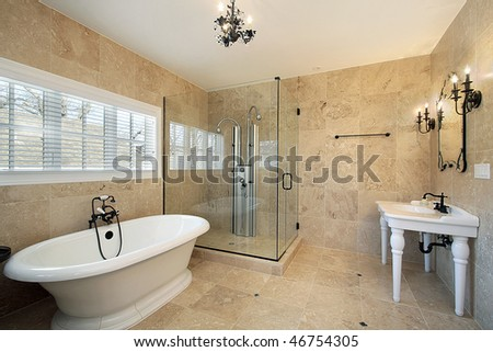 Master bath in luxury home with large glass shower - stock photo