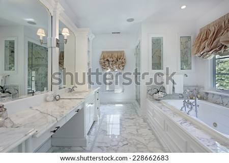 Master bath in luxury home with marble counters - stock photo