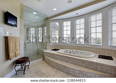 Master bath in luxury home with step up bathtub - stock photo