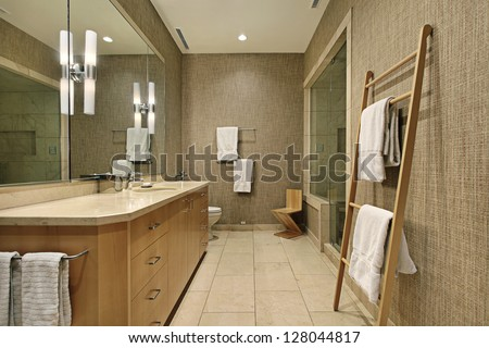 Master bath in luxury home with wood cabinetry - stock photo