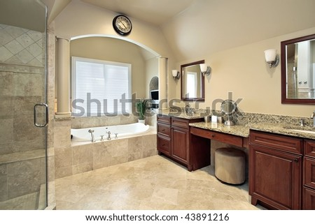 Master bath with arched tub area - stock photo