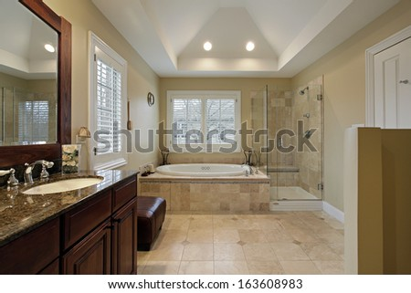 Master bath with glass shower granite counter - stock photo