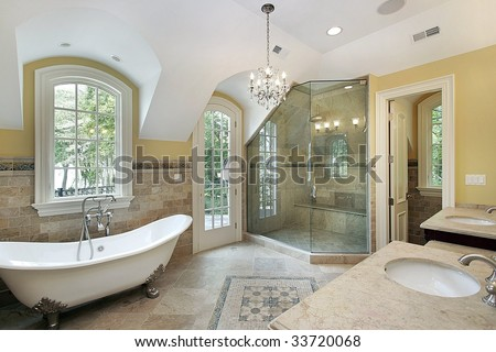 Master bath with old fashioned tub - stock photo