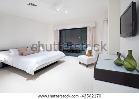 Master bedroom in luxury mansion - stock photo