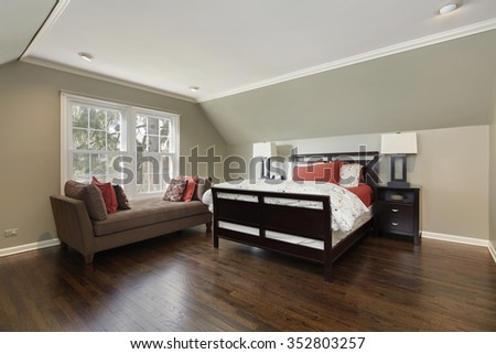 Master bedroom in suburban home with brown sofa - stock photo