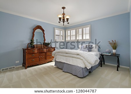 Master bedroom with blue walls - stock photo