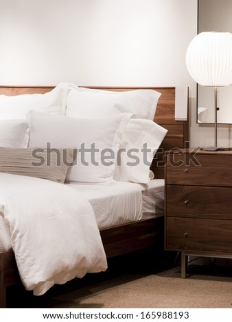 Master bedroom with white sheets in contemporary style. - stock photo