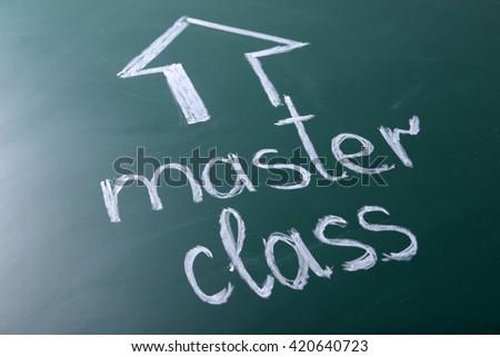 Master class inscription written with white chalk on blackboard - stock photo