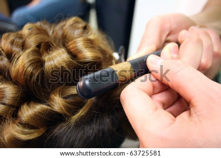 Master hairdresser cuts a customer's hair - stock photo