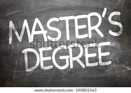 Master's Degree written on a chalkboard - stock photo
