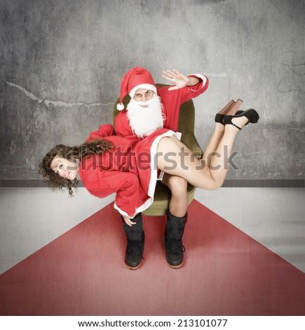 Master Santa Claus with a slave - stock photo