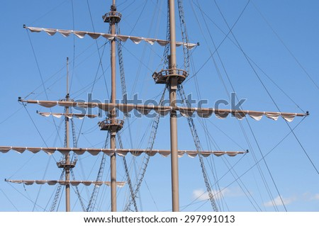 Masting of the big wooden sailing ship, detailed rigging without sails - stock photo
