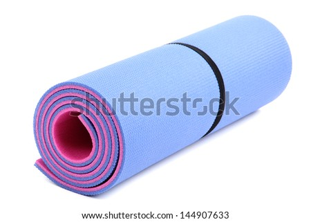 Mat for fitness isolated on white - stock photo