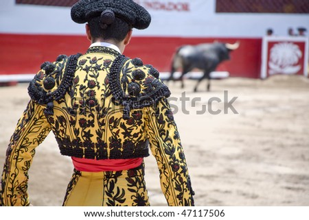 Matador in Ring with Bull - stock photo
