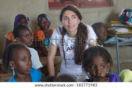 MATAM,SENEGAL-CIRCA NOVEMBER 2013:Actress Caterina Murino speaks with the children of an elementary school,Caterina Murino is the testimonial of the NGO AMREF,circa November 2013. - stock photo