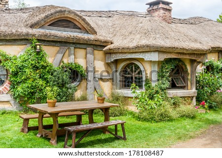 MATAMATA, NEW ZEALAND - JANUARY 11, 2014: Hobbiton - site created for filming Hollywood blockbusters HOBBIT and LORD OF THE RINGS. - stock photo