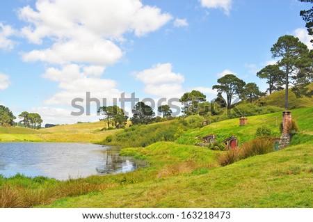 MATAMATA, NEW ZEALAND MAY 12, 2012 : Home of Hobbiton - The real Middle-Earth at the 1250 acres farmland near Matamata,  a small town in the north island of New Zealand. - stock photo