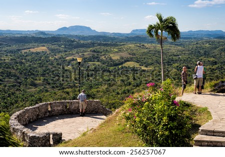 MATANZAS, CUBA - FEB 13: Group of tourists enjoying the view of El Valle de Yumurí from Mirador de Bacunayagua at the Matanzas lookout on February 13, 2015.  - stock photo