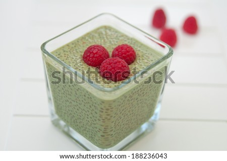 Matcha Chia Seeds Pudding with raspberry - stock photo