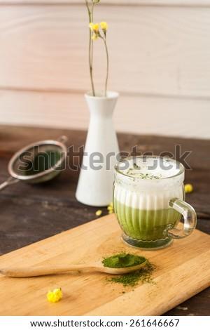 Matcha green tea latte beverage in glass mug  Selective Focus  - stock photo