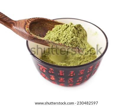 Matcha Tea in the bowl and scoop isolated on white background  - stock photo