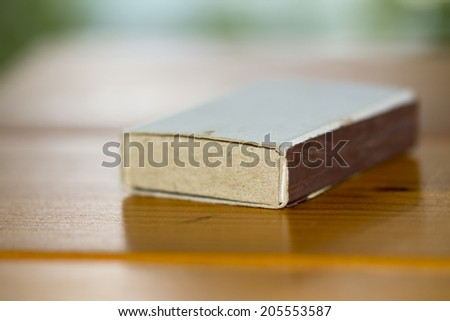matchbox on a brown table macro - stock photo
