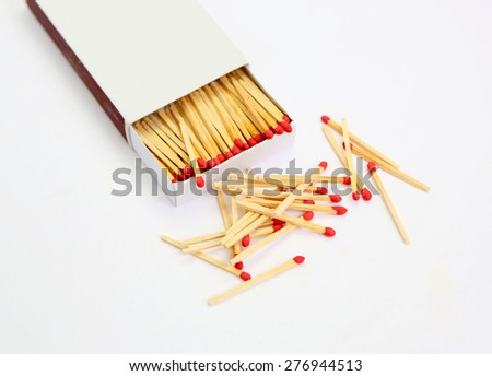 matchbox opened on white, pile match outside the box - stock photo