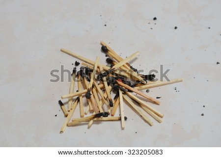 matchstick ash on the floor - stock photo