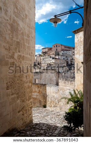 MATERA, ITALY â?? SEPTEMBER 15, 2014: Passage with lantern and view of buildings of Sassi di Matera. The city is a UNESCO World Heritage site and European Capital of Culture for 2019 - stock photo