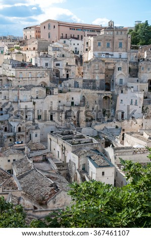 MATERA, ITALY â?? SEPTEMBER 15, 2014: Street panoramic view of buildings in ancient Sassi di Matera. The city is a UNESCO World Heritage site and European Capital of Culture for 2019 - stock photo