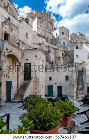 MATERA, ITALY â?? SEPTEMBER 15, 2014: Street view of buildings in Matera ancient town Sassi di Matera. The city is a UNESCO World Heritage site and European Capital of Culture for 2019 - stock photo