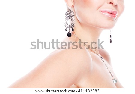 Material girl and femme fatale concept. Close up portrait of smiling rich woman wearing expensive necklace and earrings over white background. Copy-space. Studio shot - stock photo