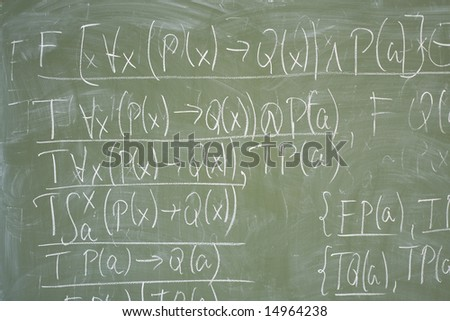 Math formulas written on the desk in classroom - stock photo