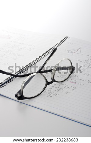 math notebook and glasses - stock photo