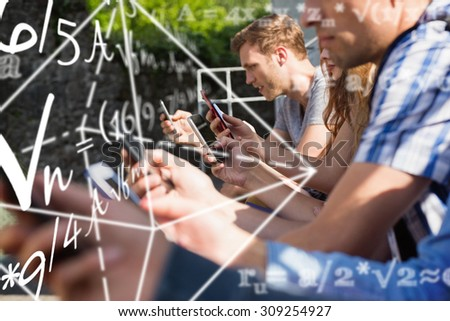 Math problems against happy students sitting in a row texting - stock photo