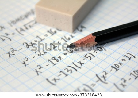 Math problems on graph paper with pencil - stock photo