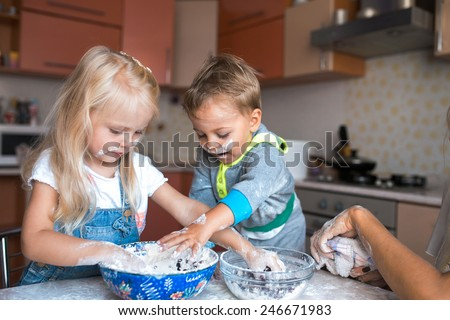 Mather have fun with kids on kitchen - stock photo