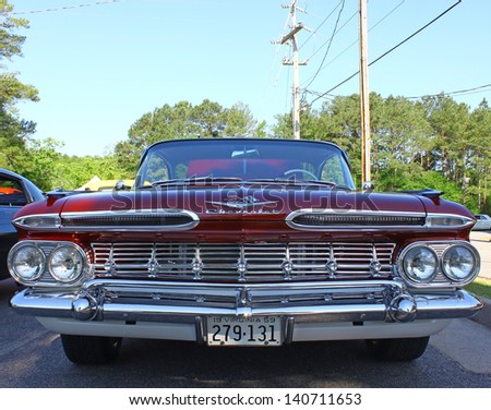 """MATHEWS, VA- JUNE 01:59 Chevrolet front view in the Annual: Vintage TV's """"Chasing Pavement Vintage Automotive Festival"""" in Mathews, Virginia on June 01, 2013 - stock photo"""