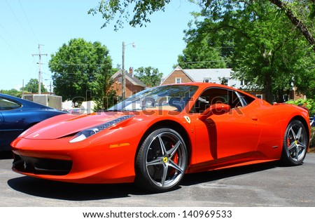 "MATHEWS, VA- JUNE 01: Ferrari 458 Italia left side in the Annual: Vintage TV's ""Chasing Pavement Vintage Automotive Festival"" in Mathews, Virginia on June 01, 2013 - stock photo"